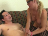Spex milf with big tits tugging on her client