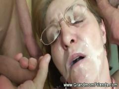 horny-granny-gets-facial-from-men