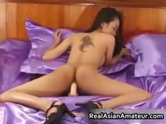 petite-asian-babe-strips-and-dildo-part2